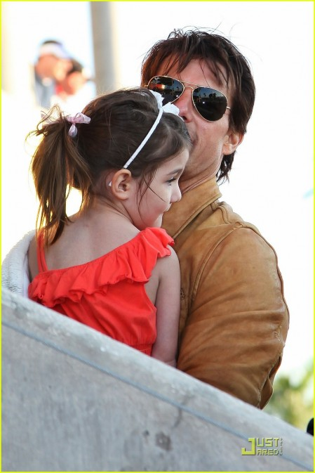 Actor Tom Cruise and daughter Suri Cruise attend Super Bowl XLIV at the Sun Life Stadium on February 7, 2010 in Miami Gardens, Florida.